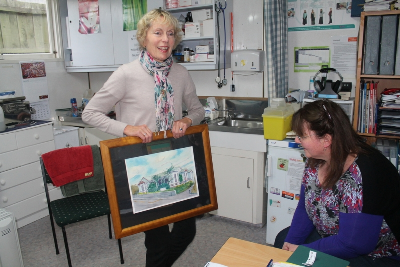 Mrs Borrie and colleague examine the art work